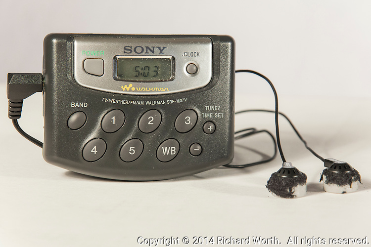 A well used Sony Walkman beckons from the past.  It still works, though the earbuds should be replaced; their foam covering has  disintegrated a tad.