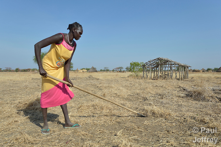 Afaf Ngor clears a field for planting near the remains of her former home in Mading Achueng, a village in Abyei, a contested region along the border between Sudan and South Sudan. Under a 2005 peace agreement, the region was supposed to have a referendum to decide which country it would join, but the two countries have yet to agree on who can vote. In 2011, militias aligned with Khartoum drove out most of the Dinka Ngok residents, including Ngor, pushing them across a river into the town of Agok. Yet more than 40,000 Dinka Ngok have since returned with support from Caritas South Sudan, which has drilled wells, built houses, opened clinics and provided seeds and tools for the returnees.