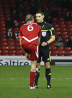 Andrew Considine getting a warning from referee Steven McLean in the Aberdeen v Queen of the South William Hill Scottish Cup 5th Round match played at Pittodrie Stadium, Aberdeen on 4.2.12.