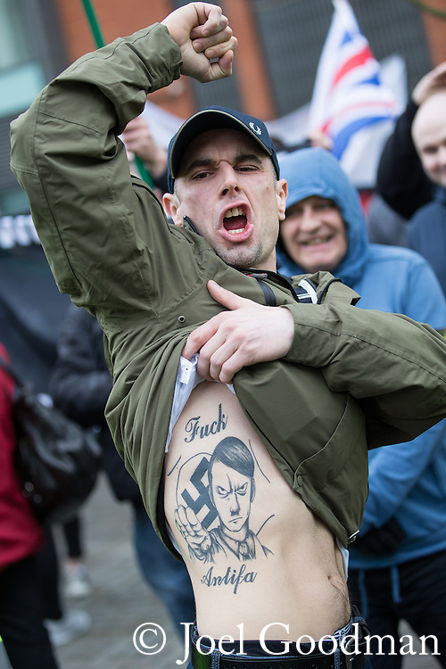 "© Joel Goodman - 07973 332324 . 28/03/2015 . Manchester , UK . A man with a large Adolf Hitler tattoo on his torso . Approximately 100 neo-Nazis gather in Manchester for "" White Pride Worldwide day "" . Photo credit : Joel Goodman"