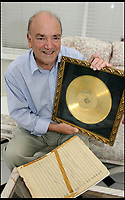 BNPS.co.uk (01202 558833)<br /> Pic: HattieMiles/BNPS<br /> <br /> Ken Mantovani with one of his fathers gold disc's.<br /> <br /> A retired businessman has spent £26,000 laying on his very own a show in tribute to his hero - the musical maestro Annunzio Paolo Mantovani.<br /> <br /> Paul Barrett, 72, will perform in a 48-piece orchestra he has hired for the performance that he is prepared to make a loss of thousands of pounds on.<br /> <br /> Mr Barrett said he plans to do 'everything bar conducting' in the musical extravaganza being hosted at the Bournemouth Pavilion Theatre in Dorset.