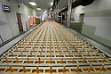 "19/06/16<br /> <br /> Nick Tanzarella, production manager, watches as sticks are added to production line.<br /> <br /> ""The last couple of days have sent the factory into meltdown,"" exclaimed Pasquale Tanzarella, director of one of the UK's largest independent ice-lolly manufacturers.<br /> <br /> In fact, today alone, his factory will make more than 200,000 ice lollies, which will be sold up and down the country through traditional ice-cream vans and shops. <br /> <br /> Demand has been so high because of the recent hot spell that the cold rooms at Franco's ices, in Kempston, Bedfordshire, are already full to bursting, with more than 40 different varieties of ice-cream and ice-lollies, and today's production of Tasty Orange lollies will probably be on sale by late afternoon.<br /> <br /> The lollies start life in a huge 2,000-litre vat, as a syrupy, bright orange liquid, before being poured into the traditional ice-lolly moulds.<br /> <br /> From there they are passed over a fast-freezer, at around -36C, to super cool the liquid into ice, which only takes around 20 minutes, before being loaded into their colourful outer wrapper.<br /> <br /> And then it's straight into wholesale boxes, stored in the factory's cold rooms, and sold the very same day.<br /> <br /> It's a super success story for this family-run business, which was founded in1964 by Pasquale's father, Domenico Tanzarella, originally to sell ice-creams through a local chain of vans.<br /> <br /> ""In the 70s we used to only supply vans within about a 60-mile radius of the factory,"" said Pasquale.<br /> <br /> ""But we've grown steadily over the years and now we export to Cyprus, Ireland and even South Africa, as well as being one of the biggest suppliers here in the UK.<br /> <br /> ""Our best seller by far is the Mr Bubble ice-lolly,"" said Pasquale. ""We were the very first company to launch a bubble gum flavoured lolly and it's been our best seller ever since.""<br /> <br /> Last year they sold more than five million of the bright blue treat and if this current heatwave continues you can be sure the company will s"