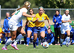 BROOKINGS, SD - AUGUST  22: Shelby Raper #4 from South Dakota State University pushes the ball against the defense of Katie Schulz #13 from Green Bay in the second half of their game Sunday afternoon at Fischback Soccer Field in Brookings. (Photo by Dave Eggen/Inertia)