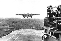 Take off from the deck of the USS HORNET of an Army B-25 on its way to take part in first U.S. air raid on Japan.  Doolittle Raid, April 1942.  (Navy)<br /> Exact Date Shot Unknown<br /> NARA FILE #:  080-G-41196<br /> WAR &amp; CONFLICT BOOK #:  1148