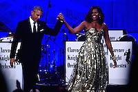 Washington, DC - September 17, 2016: President Barack Obama and first lady Michelle Obama acknowledge audience applause at the conclusion of the Phoenix Awards Dinner hosted by the Congressional Black Caucus Foundation at the Washington Convention Center, in the District of Columbia, September 17, 2016.  (Photo by Don Baxter/Media Images International)
