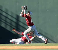 South Carolina shortstop Bobby Haney (23) grabs a pop fly but trips over left fielder Robert Beary (4) during a game between the Clemson Tigers and South Carolina Gamecocks Saturday, March 6, 2010, at Fluor Field at the West End in Greenville, S.C. Haney was slow to get up, but was unhurt. Photo by: Tom Priddy/Four Seam Images