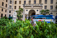 HAVANA, CUBA - SEPTEMBER 09: A gardener works in front of the Hotel Nacional De Cuba, as a tourist bus waits for passengers on 9th of September, 2015 in Havana, Cuba. <br /> <br /> Daniel Berehulak for The New York Times