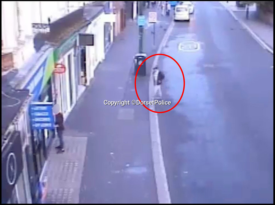 BNPS.co.uk (01202 558833)Pic: DorsetPolice/BNPS<br /> <br /> A screenshot of CCTV footage showing Kevin Boyle crossing the road to carry out the attack on Glen Morrant at around 6:25am on Friday 18th August 2017.<br /> <br /> Boyle mistakes Glen Morrant as one of the bystanders 2 hours earlier on in the evening.<br /> <br /> Circled in red is Kevin Boyle.<br /> <br /> A knife maniac who nearly killed an innocent bystander he mistook for someone he had a row with because both men had ginger hair was today jailed for 21 years.<br /> <br /> Kevin Boyle waited outside a Bournemouth nightclub for the red-headed reveller who had shoved him two hours earlier to appear.<br /> <br /> When clubber Glen Morrant walked out Boyle began to follow him by mistake because he was wearing similar clothes to the first man and also had ginger hair.<br /> <br /> Boyle slashed the 19-year-old by the throat. He was sentenced today at Winchester Crown Court.