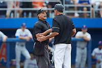 Home plate umpire Perry Costello explains a call to Wake Forest Demon Deacons head coach Tom Walter (16) during the game against the Florida Gators in the completion of Game Two of the Gainesville Super Regional of the 2017 College World Series at Alfred McKethan Stadium at Perry Field on June 12, 2017 in Gainesville, Florida. The Demon Deacons walked off the Gators 8-6 in 11 innings. (Brian Westerholt/Four Seam Images)