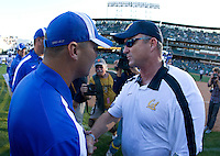 California head coach Jeff Tedford shakes hands with Presbyterian head coach Harold Nichols after the game at AT&T Park in San Francisco on September 17th, 2011.  California defeated Presbyterian, 63-12.