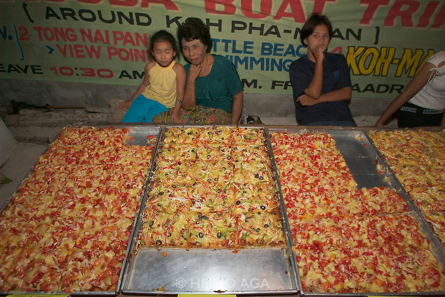 The notorious Full Moon Party at Hat Rin beach on the small Thai island of Ko Pha-Ngan is Asia's biggest regular rave event. Pizza for the hungry.