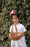 Israel, Herzlia. A girl with Shavuot basket (1999)