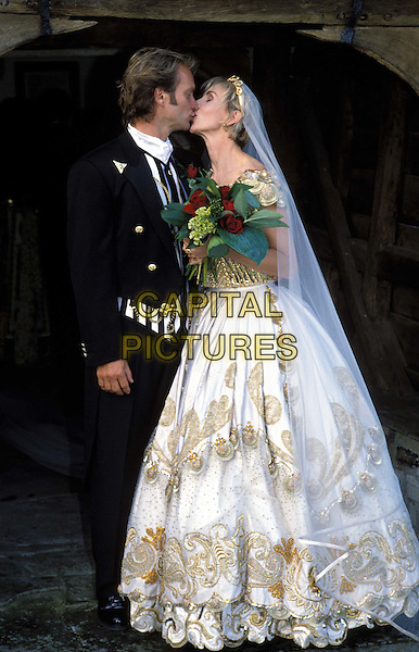 STING & TRUDI STYLER.ref: 007.www.capitalpictures.com.sales@capitalpictures.com.© Capital Pictures.wedding, bride, kiss