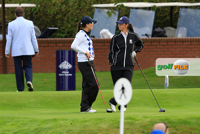 Annabel Dimmock (ENG) &amp; Andrea Lee (USA) chatting on the 1st tee during Day 2 Singles for the Junior Ryder Cup 2014 at Blairgowrie Golf Club on Tuesday 23rd September 2014.<br /> Picture:  Thos Caffrey / www.golffile.ie