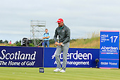 Brian McFadden rests his hot-dog during the final round  of the 2016 Aberdeen Asset Management Ladies Scottish Open played at Dundonald Links Ayrshire from 22nd to 24th July 2016:  Picture Stuart Adams, www.golftourimages.com: 22/07/2016