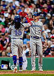 Jun 22, 2019; Boston, MA, USA; Toronto Blue Jays shortstop Freddy Galvis comes home to meet Cavan Biggio at the plate after Galvis hits a hits a 2-run home run in the 7th inning against the Boston Red Sox at Fenway Park. Mandatory Credit: Ed Wolfstein-USA TODAY Sports