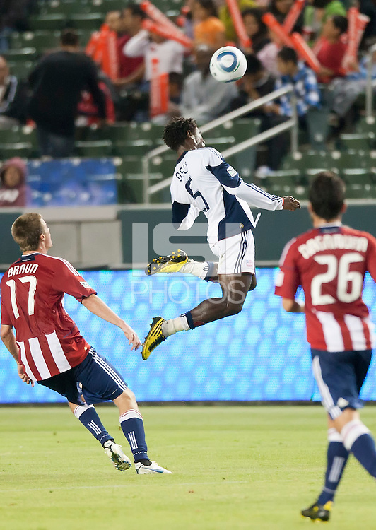 Revolution defender Emmanuel Osei (5) goes up high to head ball during the first half of the game between Chivas USA and the New England Revolution at the Home Depot Center in Carson, CA, on September 10, 2010. Chivas USA 2, New England Revolution 0.