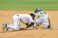 June 04, 2011:   Manhattan Jaspers inf Yoandry Galan (2) misses the tag at second base on Jacksonville Dolphins infielder Taylor Ratliff (26)  during NCAA Gainesville Regional action between Jacksonville Dolphins and Manhattan Jaspers played at Alfred A. McKethan Stadium on the campus of Florida University in Gainesville, Florida.  Jacksonville defeated Manhattan 5-4.........