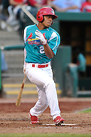 Oscar Taveras (25) of the Springfield Cardinals follows through on his swing against the Corpus Christi Hooks at Hammons Field on August 19, 2012 in Springfield, Missouri.(Dennis Hubbard/Four Seam Images)