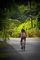 A local man rides slowly along the road at Teahupoo, Tahiti, Saturday May 2 2009. Photo: joliphotos.com