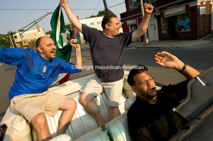 WATEBURY, CT--09 JULY 2006 -070906JS11-Italian fans, from left, Tony Mancini of Middlebury, Joe Petta of Prospect and Dave Mancici of Watertown drive around Waterbury following Italy's win over France in the World Cup finals Sunday.  Jim Shannon Republican-American