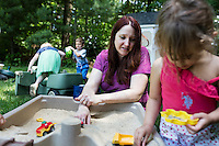 Lora Reyes is a licensed family childcare educator in Westfield, Mass., where she operates the daycare Lora's Little Ones out of her home on Thurs., June 2, 2016. Here she watches as the kids play in a sandbox outdoors before lunch. Today she was in charge of 7 children, aged 14 months to 5 years old, handling meals, playtime, and educational activities throughout the day, starting about 7am and going until 4:30pm. She uses the Mother Goose Time curriculum throughout the day. Reyes is currently pursuing an undergraduate degree in Psychology at Holyoke Community College. She started 2 years ago after earning a Child Development Associate certification.