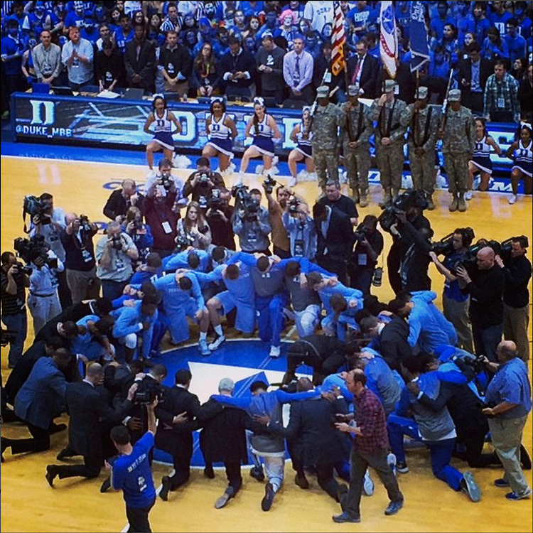 Prior to tipoff at the Duke - UNC game in Cameron, both teams gathered at midcourt for a moment of silence to honor legendary former UNC coach Dean Smith, who died recently.<br /> by dukeuniversity ift.tt/1G5rGr9 February 18, 2015 at 09:18PM