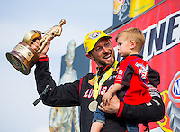 Sep 7, 2015; Clermont, IN, USA; NHRA top fuel driver Morgan Lucas celebrates with son Hunter Lucas after winning the US Nationals at Lucas Oil Raceway. Mandatory Credit: Mark J. Rebilas-USA TODAY Sports