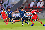 Minamino Takumi of Japan (L) competes for the ball with Khalid Al Braiki of Oman (R) during the AFC Asian Cup UAE 2019 Group F match between Oman (OMA) and Japan (JPN) at Zayed Sports City Stadium on 13 January 2019 in Abu Dhabi, United Arab Emirates. Photo by Marcio Rodrigo Machado / Power Sport Images