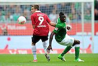 FUSSBALL   1. BUNDESLIGA   SAISON 2012/2013   3. SPIELTAG Hannover 96 - SV Werder Bremen     15.09.2012 Artur Sobiech (li, Hannover 96) gegen Assani Lukimya (re, SV Werder Bremen)