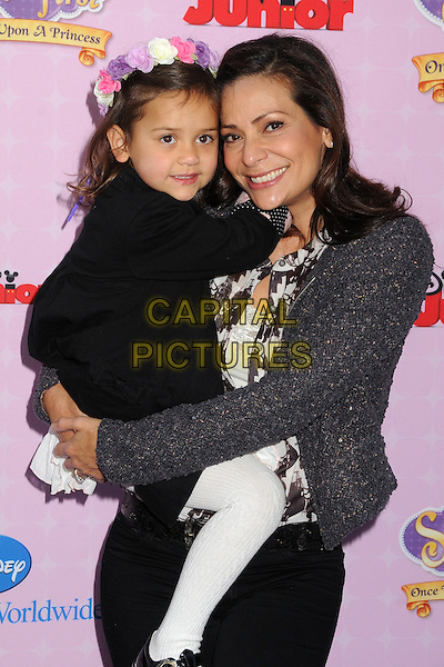 "Constance Marie & daughter .""Sofia The First: Once Upon A Princess"" Los Angeles Premiere held at Walt Disney Studios, Burbank, California, USA, 10th November 2012..half length holding carrying grey gray tweed jacket .CAP/ADM/BP.©Byron Purvis/AdMedia/Capital Pictures."