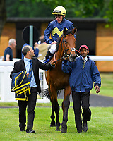 Winner of The Sorvio Insurance Brokers Maiden Stakes (Plus 10)  Polish ridden by Kieran Shoemark and trained by Roger Charlton is led into the winners enclosure during Afternoon Racing at Salisbury Racecourse on 12th June 2018