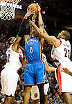 APRIL 01, 2011; Portland, OR, USA; Portland Trail Blazers forward LaMarcus Aldridge (12) and forward Marcus Camby (23) battle for a rebound with Oklahoma City Thunder point guard Russell Westbrook (0) during the third quarter of the game at the Rose Garden. The Blazers won the game 98-91.  Mandatory Credit: Steve Dykes-US PRESSWIRE