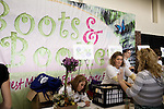 November 15, 2008. Fayetteville, NC..One thousand Army wives and active duty soldiers pregnant with what the locals call ?surge babies? were celebrated at the biggest military baby shower ever. These babies were conceived when.troops from the 82nd Airborne Division, deployed to Iraq for the surge of forces in January 2007, began returning home to Fort Bragg in November.. Volunteers attended the tables as the women entered the entrance hall. The event was billed as Boots and Booties.