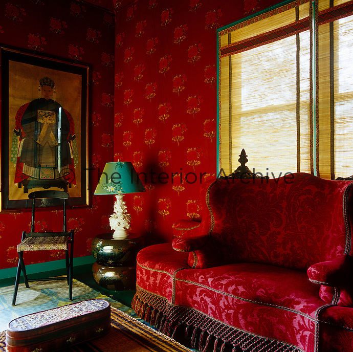 Muriel Brandolini's fabrics brighten the walls of the guest cottage giving it a rich Oriental theme