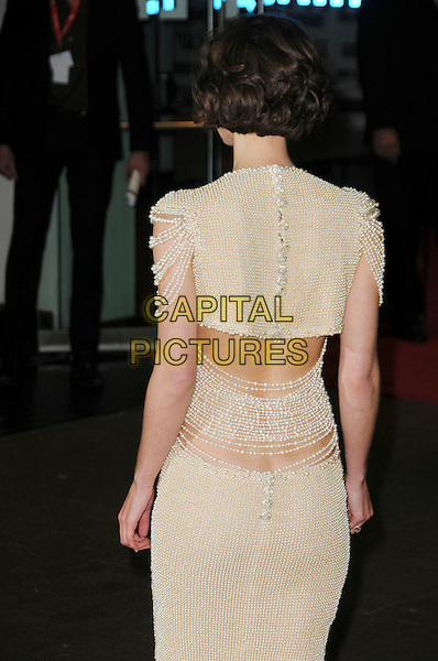 "KEIRA KNIGHTLEY.The 54th BFI London Film Festival Opening Night Gala & European Premiere of ""Never Let Me Go"" Odeon Leicester Square, London, England, UK..October 13th, 2010.half length pearl beads pearls dress cream cut out away sides sleeves Chanel yellow back rear behind .CAP/CAS.©Bob Cass/Capital Pictures."