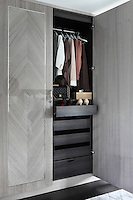 One of the built- in marquetry wardrobes in the master suite, with integrated drawers for accessories,