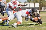 Palos Verdes, CA 09/27/13 - Ian Escutia (Peninsula #2), Austin Manigo (Lawndale #9) and Immanuel Eyo (Lawndale #7) in action during the Lawndale vs Palos Verdes Peninsula Varsity football game at Peninsula High School.