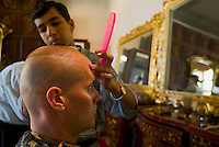 "Baghdad, Iraq, June 5, 2003.US Captain Polpek from the 422nd Civil Affairs gets a $1 hair cut at Saddam's Palace salon; at this stage of the procedings, he just said: ""a little shorter on the top, please""...."