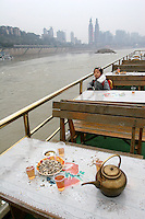 CHINA. Sichuan Province. Chongqing. On a river boat onThe Yangtze River which is at its lowest level in 150 years as a result of a country-wide drought. Chongqing is a city of over 3,000,000 people, famed for being the capital of China between 1938 and 1946 during World War II. It is situated on the banks of the Yangtze river, China's longest river and the third longest in the world. Originating in Tibet, the river flows for 3,964 miles (6,380km) through central China into the East China Sea at Shanghai.  2008.