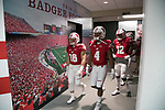 Wisconsin Badgers teammates walk to the field prior to an NCAA Big Ten Conference football game against the Maryland Terrapins Saturday, October 21, 2017, in Madison, Wis. The Badgers won 38-13. (Photo by David Stluka)