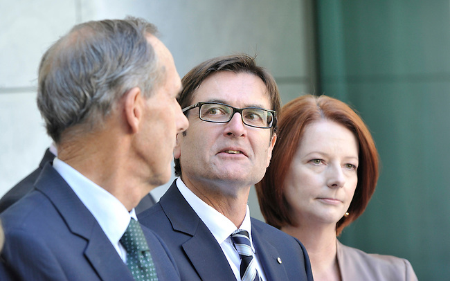 Climate Change Minister Greg Combet with Greens Leader Senator Bob Brown and Australian Prime Minister Julia Gillard during a press conference  at Parliament House, in Canberra, Australia, on Thursday, Feb. 24, 2011. The Prime Minister released details about the proposed carbon tax and emmissions trading scheme.