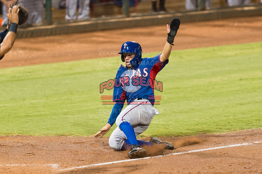 AZL Rangers third baseman Jonathan Ornelas (10) slides into home plate during an Arizona League playoff game against the AZL Indians 1 at Goodyear Ballpark on August 28, 2018 in Goodyear, Arizona. The AZL Rangers defeated the AZL Indians 1 7-4. (Zachary Lucy/Four Seam Images)