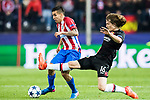 Angel Correa (l) of Atletico de Madrid fights for the ball with Tin Jedvaj of Bayer 04 Leverkusen during their 2016-17 UEFA Champions League Round of 16 second leg match between Atletico de Madrid and Bayer 04 Leverkusen at the Estadio Vicente Calderon on 15 March 2017 in Madrid, Spain. Photo by Diego Gonzalez Souto / Power Sport Images