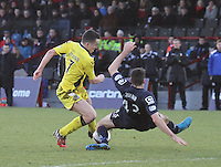 John McGinn blocked by Paul Quinn in the Ross County v St Mirren Scottish Professional Football League match played at the Global Energy Stadium, Dingwall on 17.1.15.