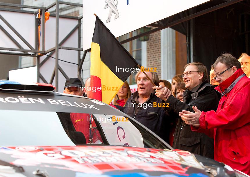 SEMI-EXCLUSIF : G&eacute;rard Depardieu donne le d&eacute;part au rallye du Condroz en Belgique. L'acteur fran&ccedil;ais &agrave; lanc&eacute; le d&eacute;part de la 40e &eacute;dition du rallye du Condroz  &agrave; Huy, en Belgique en brandissant le drapeau belge, avec au d&eacute;part, le pilote S&eacute;bastien Loeb, nonuple champion du monde, au volant de sa Citro&euml;n DS3 WRC. G&eacute;rard Depardieu est venu aussi supporter son &eacute;quipe de rallye, le pilote corse Lo&iuml;c Mattei et co-pilote Tony Barichella engag&eacute;s sur une Mitsubishi.<br /> Belgique, Huy, 1/10/2013. <br /> NO WEB, NO BLOGS.<br /> <br /> SEMI-EXCLUSIVE :  French actor G&eacute;rard Depardieu announces de departure of the 40th Condroz Rally in Belgium.<br /> French actor Gerard Depardieu holds a Belgian flag during the first day of the Condroz Rally, the last stage of the Belgian Rally Championship. G&eacute;rard Depardieu announced the departure with French rally driver, S&eacute;bastien Loeb, the most successful driver in WRC history, having won the world championship a record nine times in a row. G&eacute;rard Depardieu also came to support his French rally team ;  Lo&iuml;c Mattei and co-pilot Tony Barichella aboard a Mitsubishi. Belgium, Huy, November 1st, 2013. NO WEB, NO BLOGS.