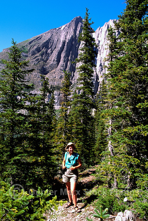 Rocky Mountains, Canadian Rockies, BC, British Columbia, Canada - Female Hiker hiking on Trail, Elk Lakes Provincial Park near Elkford, Summer (Model Released)