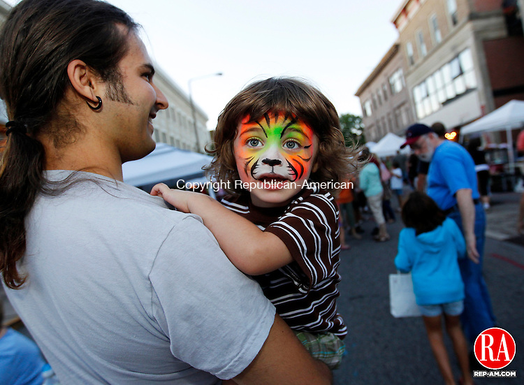 Torrington, CT- 26, August 2010-082610CM04  Asa Parish, 3 and his father, Preston, of Torrington were out enjoying the final night of the Main Street Marketplace in Torrington Thursday night. The family went to the Marketplace every Thursday night this summer.  Asa said his favorite part of the market, was getting his face painted.  Christopher Massa Republican-American