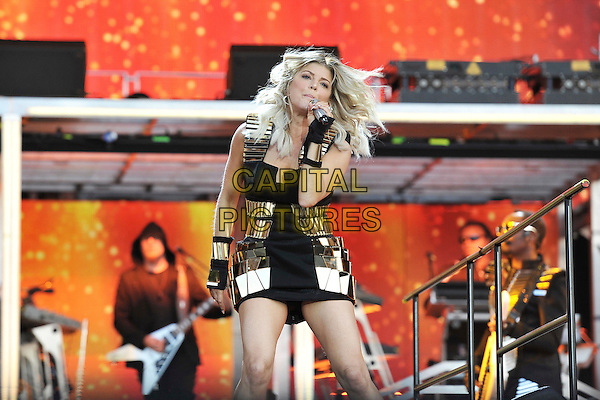Fergie of Back Eyed Peas (Stacy Ferguson).Performs on during Day One of Wireless Festival, Hyde Park, London, England, UK, 1st July 2011..half length music live on stage concert gig  black gold mini dress hands gloves fingerless microphone singing hair funny .CAP/MAR.© Martin Harris/Capital Pictures.