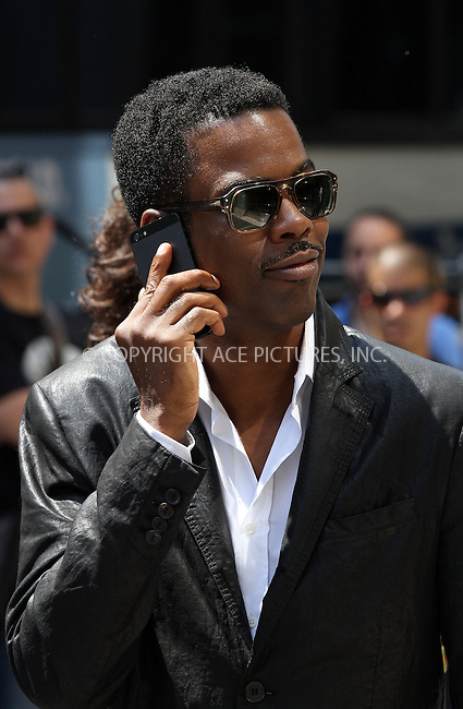 WWW.ACEPIXS.COM<br /> <br /> June 24 2013, New York City<br /> <br /> Actor and Director Chris Rock on the set of the new movie 'Finally Famous' on June 24 2013 in New York City<br /> <br /> By Line: Zelig Shaul/ACE Pictures<br /> <br /> <br /> ACE Pictures, Inc.<br /> tel: 646 769 0430<br /> Email: info@acepixs.com<br /> www.acepixs.com